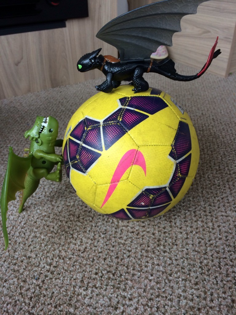 Dragon's Playing football