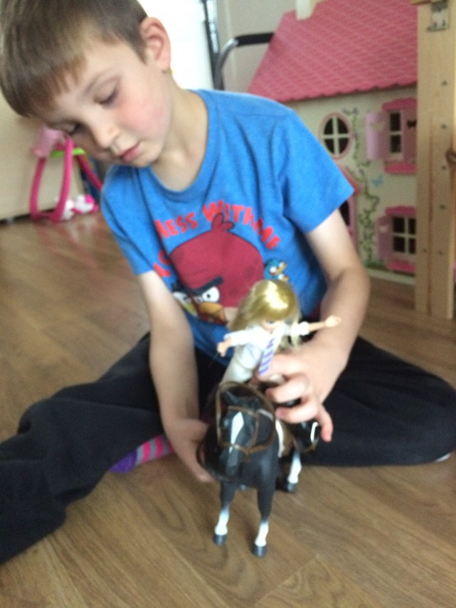 Boy Playing with Lottie