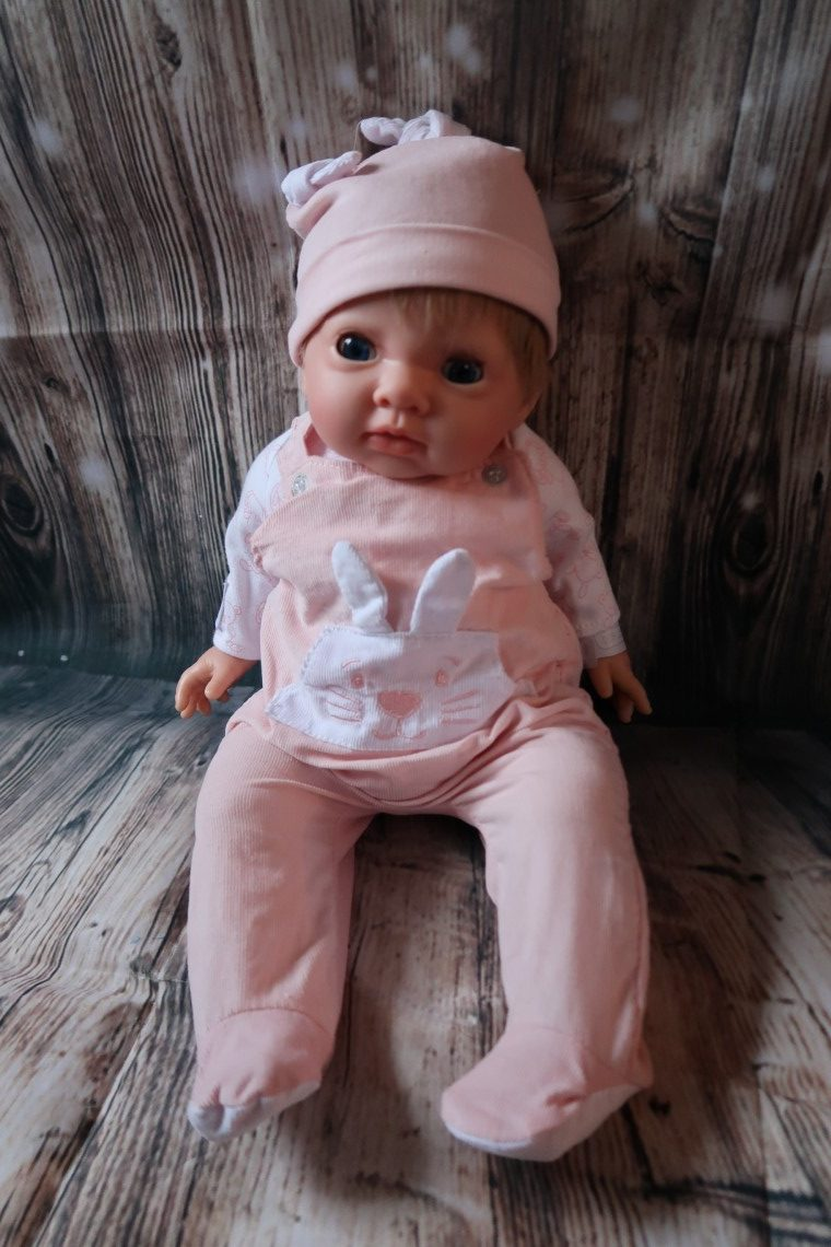 Tiny Treasures Doll sitting